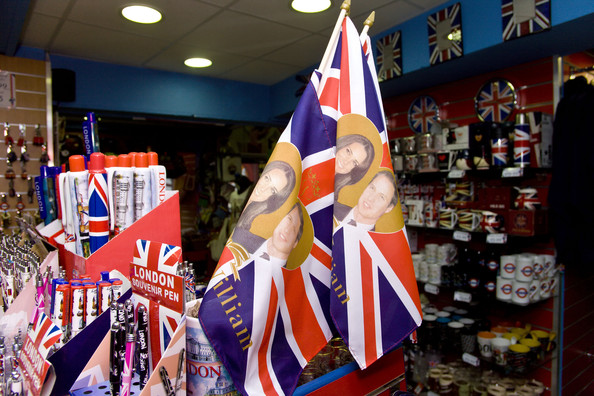 The Royal Wedding has created a cottage industry of products being sold by tourist shops in the West End of London. Many items have been made with Kate and William printed on them including posters, spoons, mugs, ashtrays, flags, framed pictures and even bells and lighters. Outside one shop there was already a bargain bin for Kate and William mugs. Another shop, the 'House of Gifts' was offering up to 50% off their items using a cutout of Kate and William at their shop entrance. Many of the items are already on sale or on offer if you buy multiple items. An artist called Lydia Leith has joined in the fun with a hand screen printed