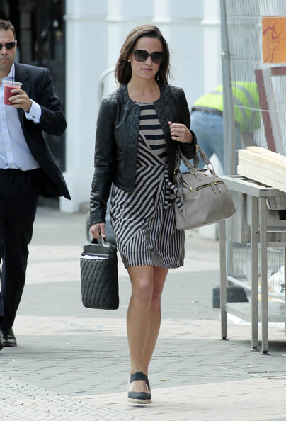 A business-like Pippa Middleton, wearing a stripey day dress, as she strides through Chelsea in London. Pippa, sister of Catherine Duchess of Cambridge, carried a black leather quilted laptop bag - which she'd matched with her cropped leather jacket.