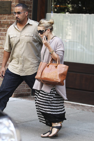Mary-Kate and Ashley Olsen spotted leaving their New York hotel.