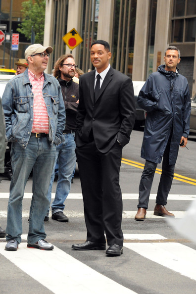 "A cheerful Will Smith filming the much anticipated ""Men in Black 3"" in New York. The actor seemed to be enjoying his work, as he laughed and joked with director Barry Levinson on set. The actor reportedly brings in around $20 million per movie."