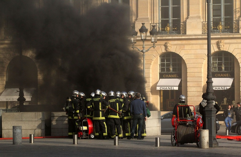 a fire breaks out in the posh place vendome parking garage in the center of paris sending a. Black Bedroom Furniture Sets. Home Design Ideas
