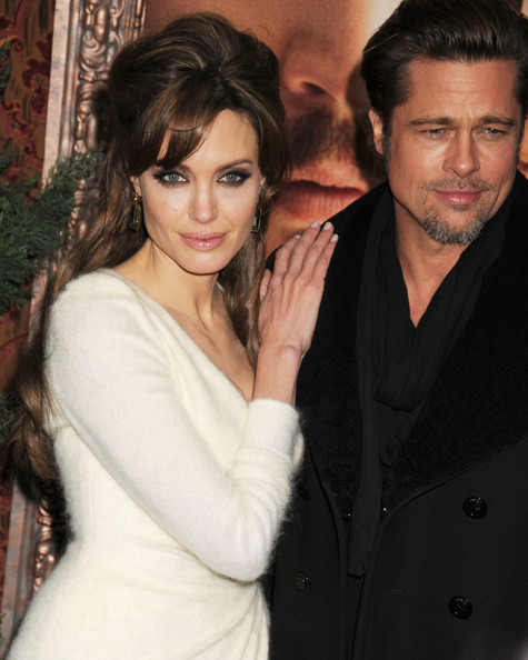 Angelina Jolie, looking fabulous in a Versace gown, and Brad Pitt dazzle on