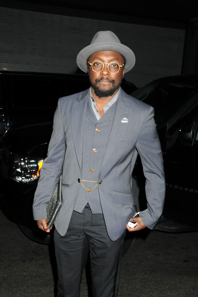 William Adams, aka will.i.am of The Black Eyed Peas, stops to pose with fans before heading into his midtown hotel in New York City []