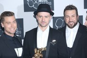 Justin Timberlake (C), Lance Bass (L), and Joey Fatone (R) attend press room of the 2013 MTV Video Music Awards at the Barclays Center in the Brooklyn borough of New York City.